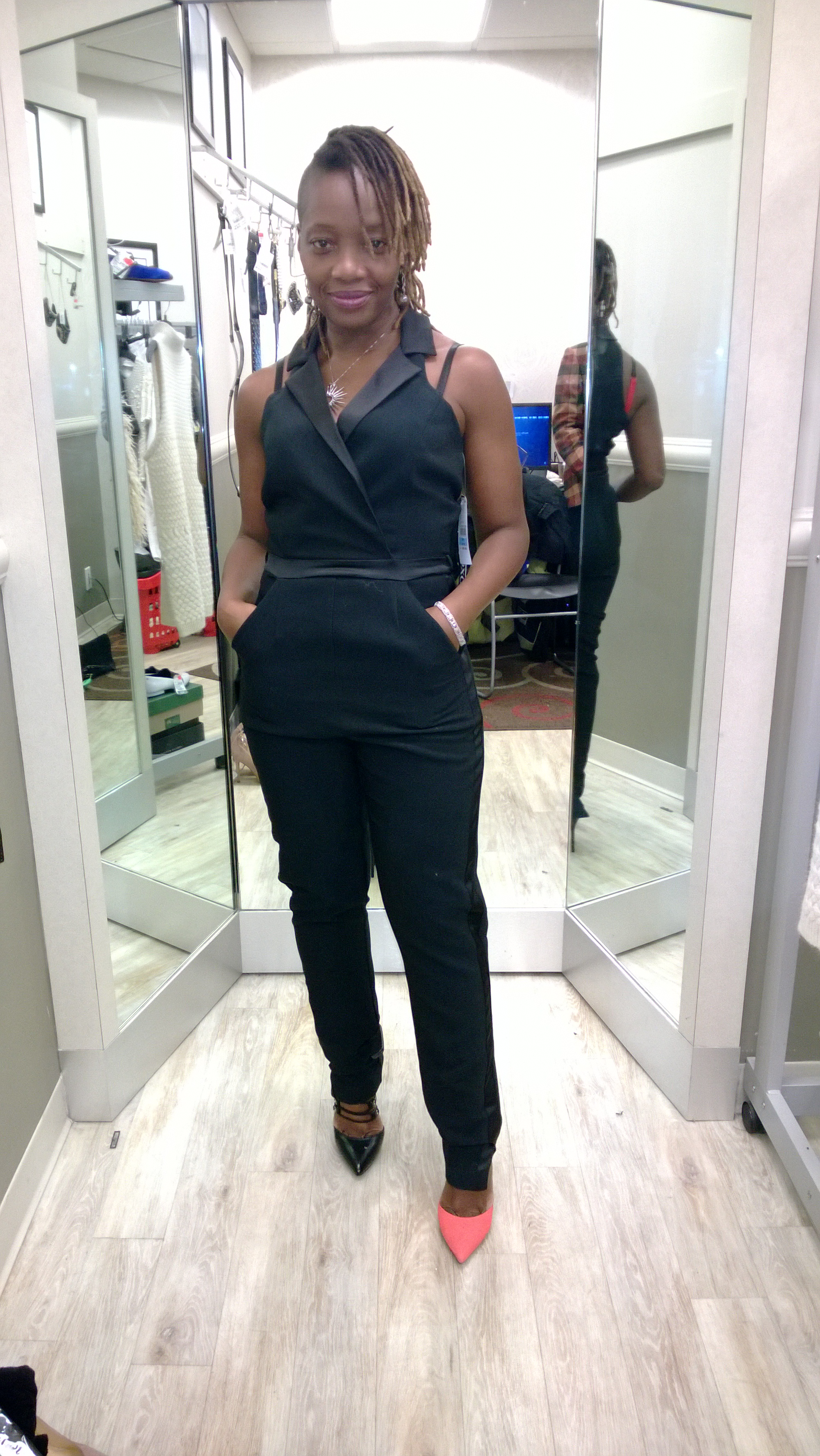 This black jumpsuit fits just right and hits all the curves but I was still  undecided. I paired it with black and salmon pumps to see which one would  pop.