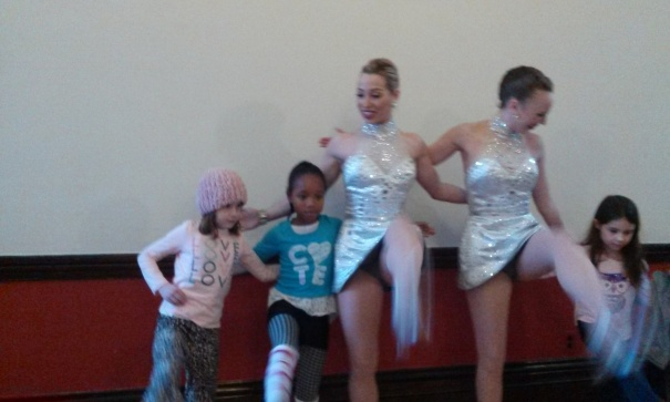 My 8-year old daughter Kameko (in stripped leg-warmers) learns how to strut and kick  with the glamorous Rockettes