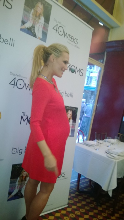 RED HOTTT! Molly Sims who is 8-months  pregnant stuns in red.