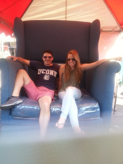 Megan and Steve werer having a blast at the food festival . Even taking pics iin the oversized chair