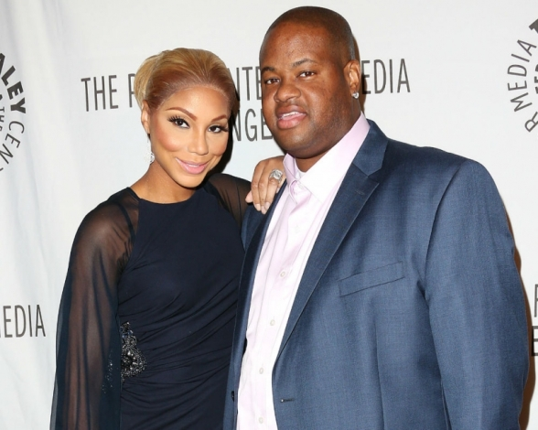 Tamar with her right hand, husband (Vince) Vincent Herbert